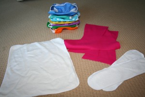bamboo flat on left, PUL covers at the back (cute colours!), hot pink microfleece liners, booster pads made from leftovers on right